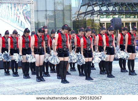 KAOHSIUNG, TAIWAN -- JUNE 17, 2015: Students from the Shu-Te High School perform a free outdoor dance for the start of the Dragon Boat Festival.