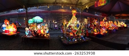 KAOHSIUNG, TAIWAN -- MARCH 6, 2015: Colorful lanterns to celebrate the Chinese year of the goat are on display along the banks of the Love River during the traditional Lantern Festival. - stock photo