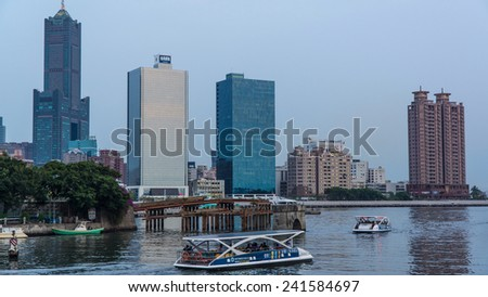 Kaohsiung, Taiwan, May,8,2014 : A Scene of Love Pier With Ferries Power By Solar Panels. Tourists Get on The Solar Powered Boat to Make A Tour Around The Love River And Kaohsiung Port.