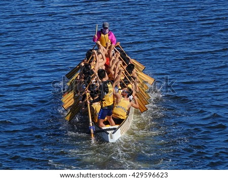 KAOHSIUNG, TAIWAN -- MAY 27, 2016: An unidentified team trains on the Love River in preparation for the upcoming Dragon Boat Festival.