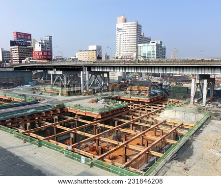 KAOHSIUNG, TAIWAN -- NOVEMBER 2, 2014:  A large underground construction project outside Kaohsiung Railway Station, that is part of the new light rail system. - stock photo