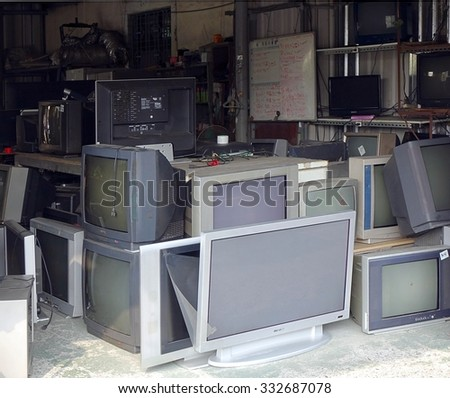 KAOHSIUNG, TAIWAN -- OCTOBER 17, 2015: A local store for the repair and recycling of traditional and flat screen televisions. - stock photo
