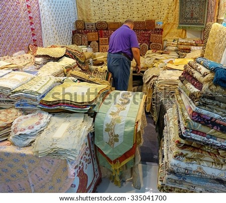 KAOHSIUNG, TAIWAN -- OCTOBER 8, 2015: A stall selling oriental carpets and rugs at a local trade fair.  - stock photo