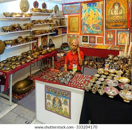 KAOHSIUNG, TAIWAN -- OCTOBER 8, 2015: A stall sells Tibetan religious artifacts at a local trade fair. - stock photo