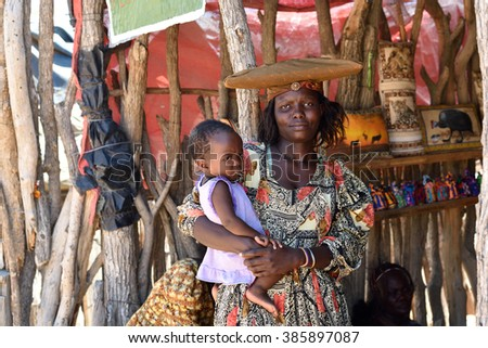 KAOKOLAND, NAMIBIA - FEB 1, 2016: Unidentified Herero Woman with her daughter in traditional clothes near Opuwo. Namibia. The Herero belonging to Bantu group, with about 240,000 members alive today.