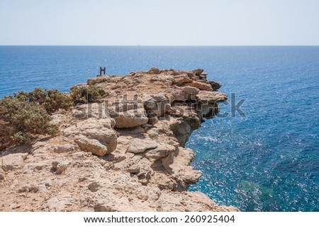 Kap Trypiti, the most southern point of Europe. At this point a sculpture of an oversized chair can be seen. Gavdos is, in spite of the southernmost greek island a very green island  - stock photo