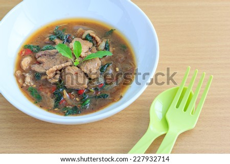 Kapao Moo(Thai Food), spicy stir fried pork with holy basil - stock photo