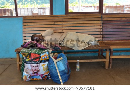 KAPIRI MPOSHI,ZAMBIA–DECEMBER 4: old man sleeping at the station of Tazara the day before catching the train that goes 2 times a week in Kapiri Mposhi ,Zambia December 4,2011