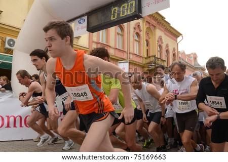 KAPOSVAR, HUNGARY - APRIL 3: Runners at the start at the T-Home Vivicitta Running Race on April 3, 2011 in Kaposvar, Hungary. - stock photo
