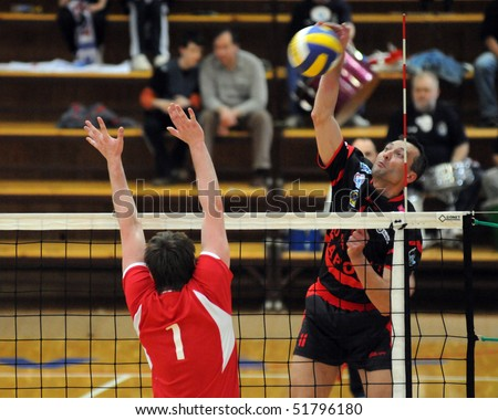 KAPOSVAR, HUNGARY - APRIL 24: Sandor Kantor (R) strikes the ball at a Hungarian National Championship Final volleyball game Kaposvar vs. Kecskemet, April 24, 2010 in Kaposvar, Hungary.