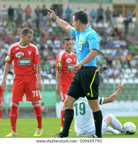 KAPOSVAR, HUNGARY - AUGUST 4: Istvan Vad II. (referee) in action at a Hungarian National Championship soccer game Kaposvar (white) vs Debrecen (red) August 4, 2012 in Kaposvar, Hungary.