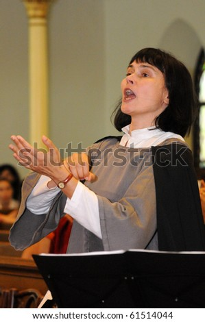 KAPOSVAR, HUNGARY - AUGUST 26: Kardi Hunt conducts at the IV. Pannonia Cantat Youth Choir Festival August 26, 2010 in Kaposvar, Hungary - stock photo
