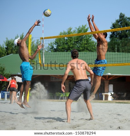 KAPOSVAR, HUNGARY - AUGUST 4: Leonel Munder (L) in action at a ROAK Viragfurdo Kupa beach volleyball competition, August 4, 2013 in Kaposvar, Hungary. - stock photo
