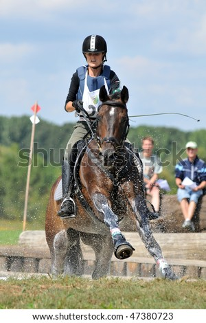 KAPOSVAR, HUNGARY - AUGUST 30: Unidentified competitor with her horse on a Hungarian Cross-Country Championship, August 30, 2008 in Kaposvar, Hungary. - stock photo