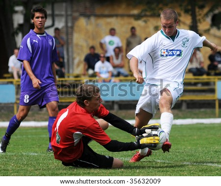 KAPOSVAR, HUNGARY - AUGUST 19: Unidentified soccer players in action at the Hungarian National Championship under 19 game between Kaposvari Rakoczi FC and Ujpesti TE August 19, 2009 in Kaposvar.
