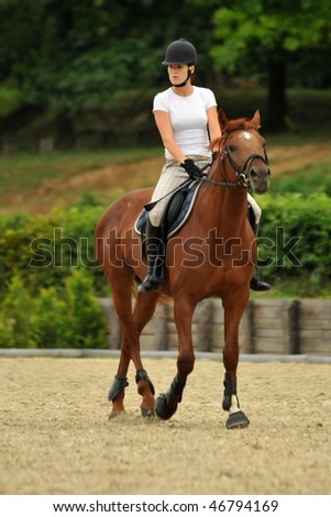KAPOSVAR, HUNGARY - AUGUST 5: Zsuzsanna Voros (olympic champion in modern pentathlon) with her horse on a training , August 5, 2008 in Kaposvar, Hungary