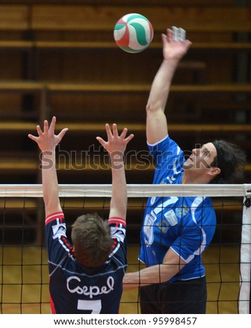 KAPOSVAR, HUNGARY - FEBRUARY 23: Andras Geiger (R) in action at a Hungarian volleyball National Championship game Kaposvar (blue) vs. Csepel ( deep blue), on February 23, 2012 in Kaposvar, Hungary. - stock photo