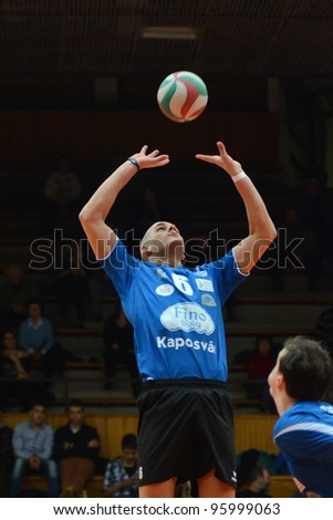 KAPOSVAR, HUNGARY - FEBRUARY 23: Balint Magyar (6) in action at a Hungarian volleyball National Championship game Kaposvar (blue) vs. Csepel ( deep blue), on February 23, 2012 in Kaposvar, Hungary. - stock photo