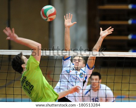 KAPOSVAR, HUNGARY - FEBRUARY 25: Istvan Toth (C) in action at a Hungarian National Championship volleyball game Kaposvar (white) vs. Sumeg (green), February 25, 2014 in Kaposvar, Hungary. - stock photo