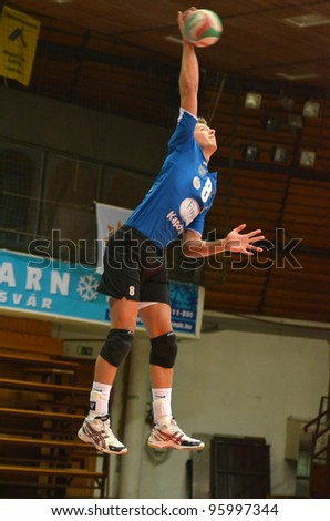 KAPOSVAR, HUNGARY - FEBRUARY 23: Roland Gergye in action at a Hungarian volleyball National Championship game Kaposvar (blue) vs. Csepel ( deep blue), on February 23, 2012 in Kaposvar, Hungary. - stock photo