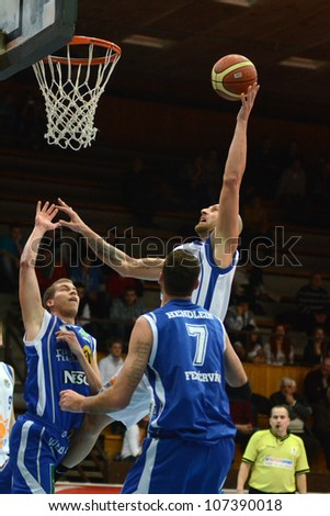 KAPOSVAR, HUNGARY - FEBRUARY 22: Unidentified players in action at a Hungarian Cup basketball game with Kaposvar (white) vs. Fehervar (blue) on February 22, 2012 in Kaposvar, Hungary.
