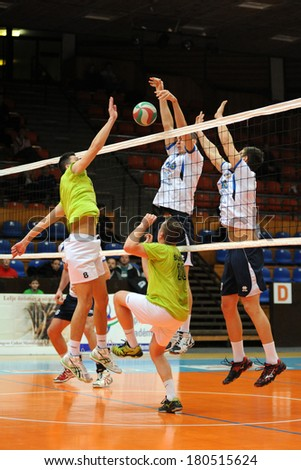 KAPOSVAR, HUNGARY - FEBRUARY 25: Unidentified players in action at a Hungarian National Championship volleyball game Kaposvar (white) vs. Sumeg (green), February 25, 2014 in Kaposvar, Hungary.