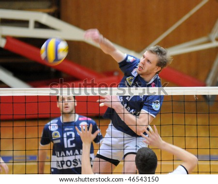 KAPOSVAR, HUNGARY - FEBRUARY 9:Zoltan Kovacs (C) strikes the ball at a Hungarian National Championship volleyball game Kaposvar vs. Kecskemet, February 9, 2010 in Kaposvar, Hungary.