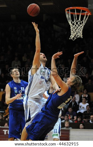 KAPOSVAR, HUNGARY - JANUARY 16: Gergely David (C) in action at Hungarian National Championship basketball game with Kaposvar vs Zalaegerszeg on January 16, 2010 in Kaposvar, Hungary.