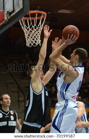 KAPOSVAR, HUNGARY - JANUARY 30: Mate Medve (R) in action at a Hungarian National Championship basketball game Kaposvar vs Pecs January 30, 2011 in Kaposvar.
