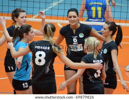 KAPOSVAR, HUNGARY - JANUARY 23: Miskolc players celebrate at the Hungarian NB I. League woman volleyball game Kaposvar vs Miskolc, January 23, 2011 in Kaposvar, Hungary. - stock photo