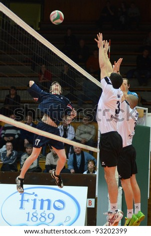 KAPOSVAR, HUNGARY - JANUARY 15: Unidentified players in action at a Hungarian volleyball National Championship game Kaposvar (white) vs. Csepel (blue), on January 15, 2012 in Kaposvar, Hungary.