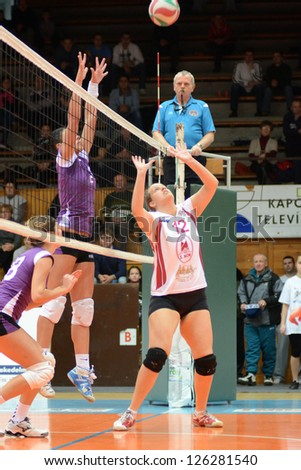KAPOSVAR, HUNGARY - JANUARY 27: Zsofia Horvath (in white) in action at the Hungarian I. League volleyball game Kaposvar (white) vs Ujpest (purple), January 27, 2013 in Kaposvar, Hungary.