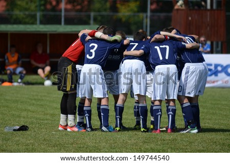KAPOSVAR, HUNGARY - JULY 20: Unidentified players in action at the IX. Youth Football Festival under 17 match SYFA West R (blue)(SCO) vs. Rakoczi FC (green) (HUN) on July 20, 2013 in Kaposvar, Hungary - stock photo