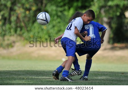 KAPOSVAR, HUNGARY - JULY 22: Unidentified players in action at the V. Youth Football Festival match Balatonszemes (HUN) vs. Semanin (CZE) - July 22, 2009 in Kaposvar, Hungary