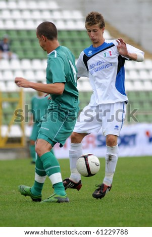 KAPOSVAR, HUNGARY - JULY 24: Unidentified players in action at the V. Youth Football Festival Under 17 Final Rakoczi FC (HUN) vs Brescia Academy (ITA) July 24, 2010 in Kaposvar, Hungary