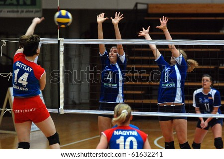 KAPOSVAR, HUNGARY - MARCH 3: Battlay (L) strikes the ball at the Hungarian Cup woman volleyball game Kaposvar vs. Vasas, March 3, 2007 in Kaposvar, Hungary.