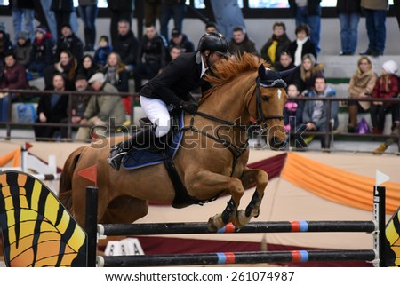 KAPOSVAR, HUNGARY - MARCH 15: Laszlo Gombos jumps with his horse (Eragon) on the Masters Tournament International Jumping Competition, March 15, 2015 in Kaposvar, Hungary