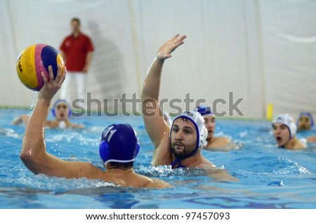 KAPOSVAR, HUNGARY - MARCH 7: Marton Chilko (blue 11) in action at a Hungarian national championship water-polo game Kaposvar (white) vs. Eger (blue) on March 7, 2012 in Kaposvar, Hungary