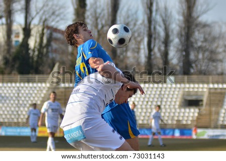 KAPOSVAR, HUNGARY - MARCH 12: Milan Peric (in white) in action at a Hungarian National Championship soccer game Kaposvar vs Siofok March 12, 2011 in Kaposvar, Hungary.
