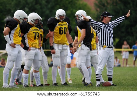 KAPOSVAR, HUNGARY - MAY 20: An unidentified referee in action an American football game Goldenfox vs. Budapest Cowboys, May 20, 2007 in Kaposvar, Hungary. - stock photo