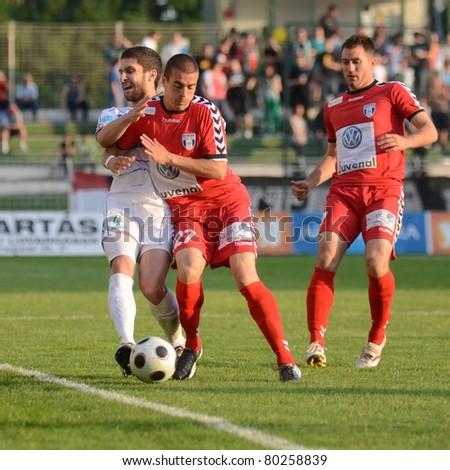 KAPOSVAR, HUNGARY - MAY 14: Drazen Okuka (in white 13) in action at a Hungarian National Championship soccer game - Kaposvar vs Szolnok on May 14, 2011 in Kaposvar, Hungary. - stock photo