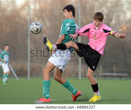 KAPOSVAR, HUNGARY - NOVEMBER 13: Bence Kovacs (in green) in action at the Hungarian National Championship under 17 game between Kaposvar and Szentlorinc November 13, 2010 in Kaposvar, Hungary.