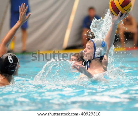 KAPOSVAR, HUNGARY - NOVEMBER 14: Gyenes (L) and Juhasz-Szelei in action at a Hungarian National Championship water-polo game (Kaposvar vs Kecskemet), November 14, 2009 in Kaposvar, Hungary