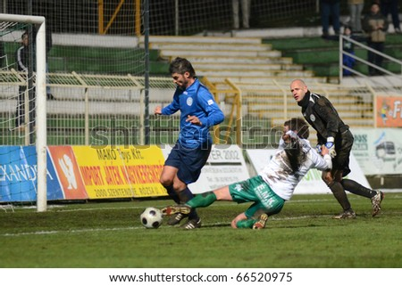 KAPOSVAR, HUNGARY - NOVEMBER 27: Milan Peric (in white) in action a Hungarian National Championship soccer game Kaposvar vs Zalaegerszeg November 27, 2010 in Kaposvar, Hungary.