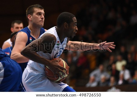 KAPOSVAR, HUNGARY - OCTOBER 6: Jaytornah Wisseh (white 33) in action at Hungarian Championship basketball game with Kaposvar (white) vs. Sopron (blue) on October 6, 2016 in Kaposvar, Hungary.