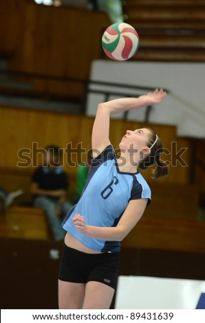 KAPOSVAR, HUNGARY - OCTOBER 16: Kamilla Gyorbiro (blue 6) in action at the Hungarian NB I. League woman volleyball game Kaposvar (blue) vs Ujpest (white), October 16, 2011 in Kaposvar, Hungary.
