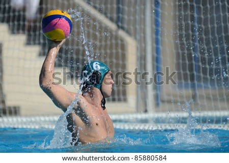 KAPOSVAR, HUNGARY - OCTOBER 1: Peter Kovacs in action at a Hungarian national championship water-polo game between Kaposvar (white) and Honved (green) on October 1, 2011 in Kaposvar, Hungary