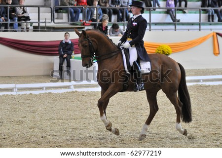 KAPOSVAR, HUNGARY - OCTOBER 9: Pia Fortmuller (CAN) and her horse (Orion) in action at the Dressage World Cup Competition October 9, 2010 in Kaposvar, Hungary.