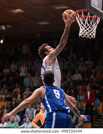 KAPOSVAR, HUNGARY - OCTOBER 6: Roland Hendlein (white 11) in action at Hungarian Championship basketball game with Kaposvar (white) vs. Sopron (blue) on October 6, 2016 in Kaposvar, Hungary.