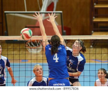KAPOSVAR, HUNGARY - OCTOBER 23: Unidentified players in action at a Hungarian NB I. League woman volleyball game Kaposvar vs Bekescsaba, October 23, 2011 in Kaposvar, Hungary. - stock photo